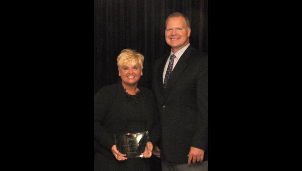 Century Unit School District No. 100 superintendent Leslie Varble was honored as a Superintendent of Distinction from the Shawnee Region of the IASA luncheon in Springfield on April 24. From left are Varble and state superintendent Dr. Tony Smith. Photo provided.