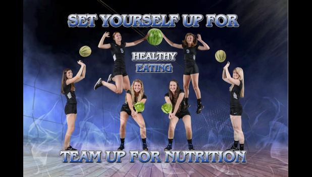 The volleyball team was one of many sports teams and clubs that helped make healthy eating posters that now hang in the A-JCHS cafeteria.