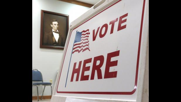 """A portrait of Abraham Lincoln is on display at the Union County Courthouse in Jonesboro, where a """"Vote Here"""" sign was seen on the night of Election Day, Tuesday, Nov. 3."""