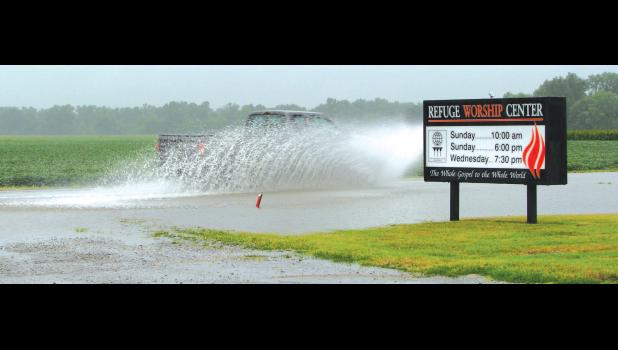 A pickup truck made its way through water on Illinois Route 146 near Ware early last Saturday afternoon. At the time, water was covering nearly half of the highway.