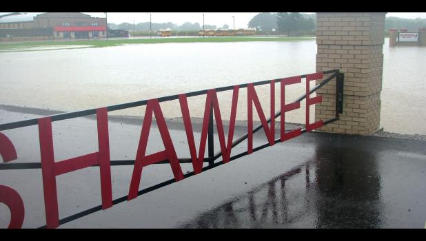 Heavy rain on Saturday left the grounds in front of the Shawnee school district buildings in Wolf Lake under water. The picture was taken early Saturday afternoon. Water did not seep into the school buildings.