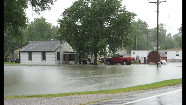 Heavy rain was still falling early last Saturday afternoon when this picture was taken along Illinois Route 3 in Wolf Lake.