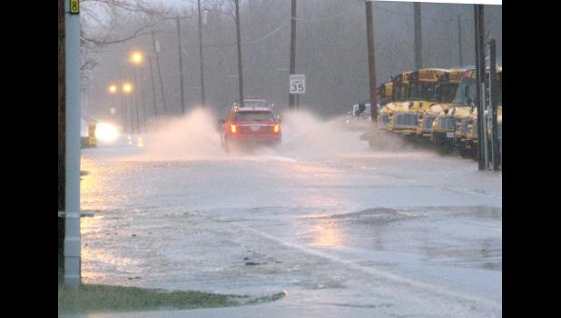 Water covered a low-lying area on old U.S. Route 51 in downtown Cobden last Saturday evening.