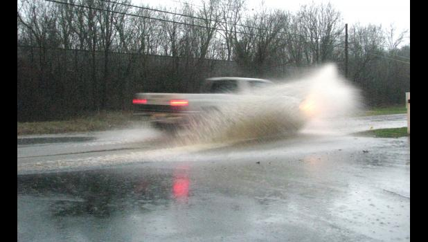 A pickup truck drove through high water on West Vienna Street in Anna last Saturday evening.