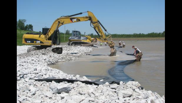 Volunteers worked last Saturday on a sand boil along the Mississippi River levee west of Wolf Lake. The sand boil was on the east side of the levee, between the river and the Union County community. The work done at the site was seen as a more permanent solution to a recurring problem.
