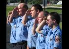 Anna Fire Department personnel salute during Sunday morning's ceremony which commemorated the Sept. 11, 2001, terrorist attacks on the nation.