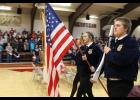 FFA members Kelsey McCrite, Rileigh Petermichel and David Mitchell, retired the colors.