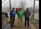 Shawnee Community College students Brandon Cummins of Metropolis, George Barnhill of Grand Chain and Caleb Parks of Golconda spent their winter break dismantling a greenhouse. Plans are for the greenhouse to be reassembled at the college's main campus near Ullin. Shawnee Community College photo.