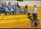 New K-9 officer Kaiser waited patiently while his handler, Deputy Eric Ralls, answered questions from 3rd graders at Anna Junior High School on Wednesday, Feb. 15. Photo by Amber Skelton.