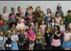 "Lick Creek School students in grades 1 through 5 sang ""Somewhere Over the Rainbow"" to close out ""The Wizard of Oz""-themed show which was performed for visiting grandparents. Photo by Benjamin Marxer."