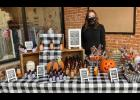 Madilyn Gawrych-Turner, founder of The Farmer's Granddaughter: Southern Illinois Scents, is shown at the debut launching of her business in front of the Mud Dress in downtown Anna at an October event. Photo provided.