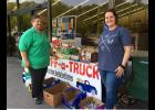 Paula Stairs, left, with Shawnee Development Council, and Stephanie Rhodes, with the Union County Farm Bureau, are shown with items which were collected during the WIBH Radio Stuff-a-Truck Food Drive. Photo provided.